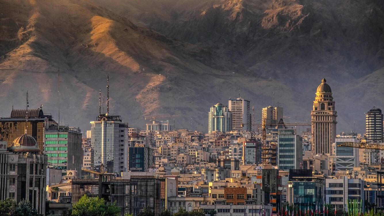 Tehran city building at the feet of the Alborz mountain range separating the rest of Iran from the Caspian sea basin, displaying the growth and development experienced by the Iranian capital.