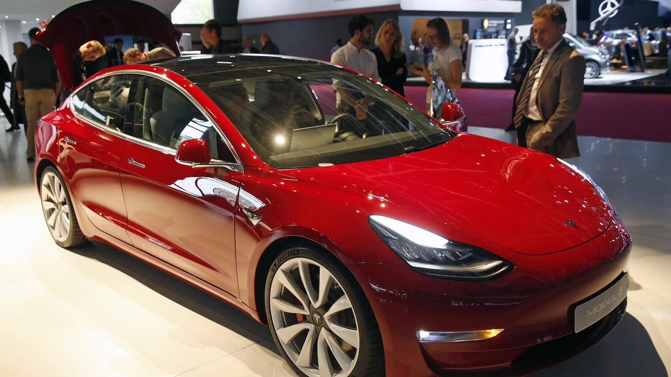 PARIS, FRANCE - OCTOBER 02:  A Tesla Model 3 automobile is on display during the first press day of the Paris Motor Show at the Parc des Expositions at the Porte de Versailles on October 2, 2018 in Paris. The Paris Motor Show will present the latest models from the world's leading car manufacturers at the Paris Expo Exhibition Center from October 4 to 14, 2018.  (Photo by Chesnot/Getty Images)