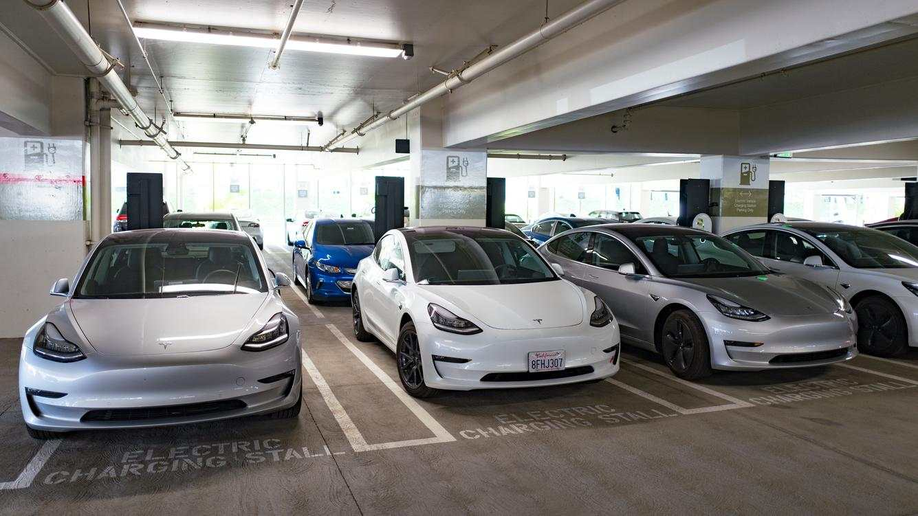 Four Tesla Model 3 electric cars from Tesla Motors are visible charging at an electric vehicle charging station in San Ramon, California, September 26, 2018. (Photo by Smith Collection/Gado/Getty Images)