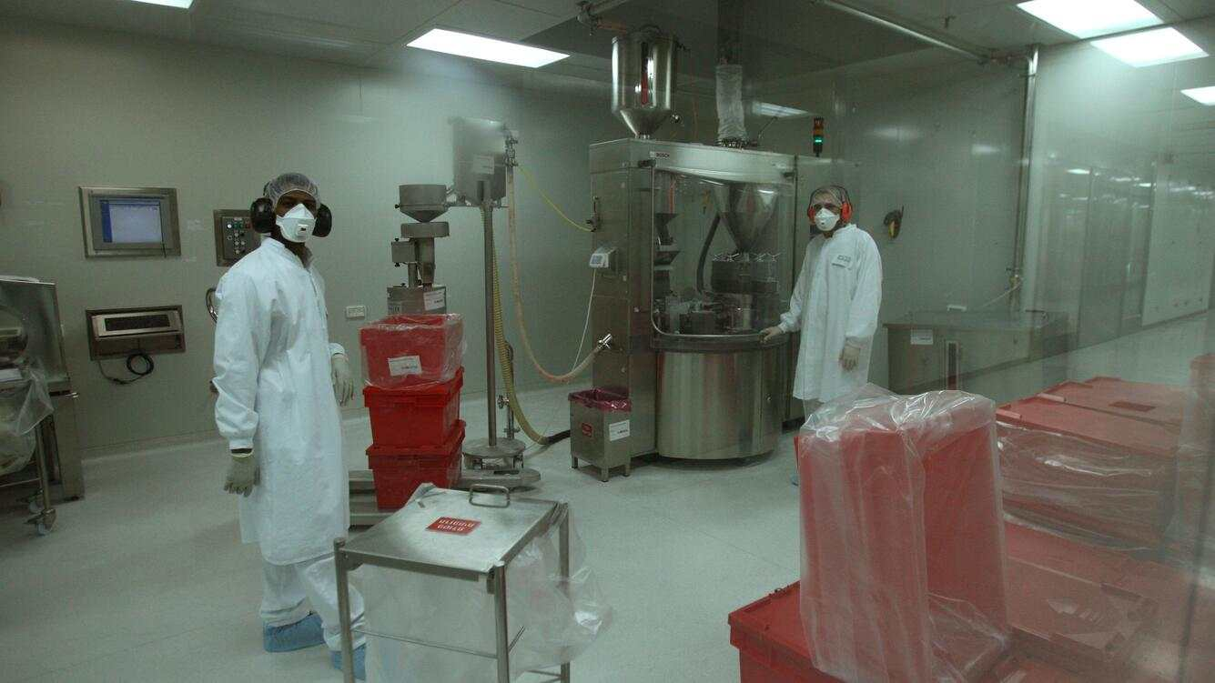 Teva Pharmaceuticals workers wear special clothing as they prepare generic drugs in a clean room at the company's manufacturing plant March 10, 2008 in Jerusalem. Teva is regarded as the world's largest generic drug maker. (Photo by Uriel Sinai/Getty Images)