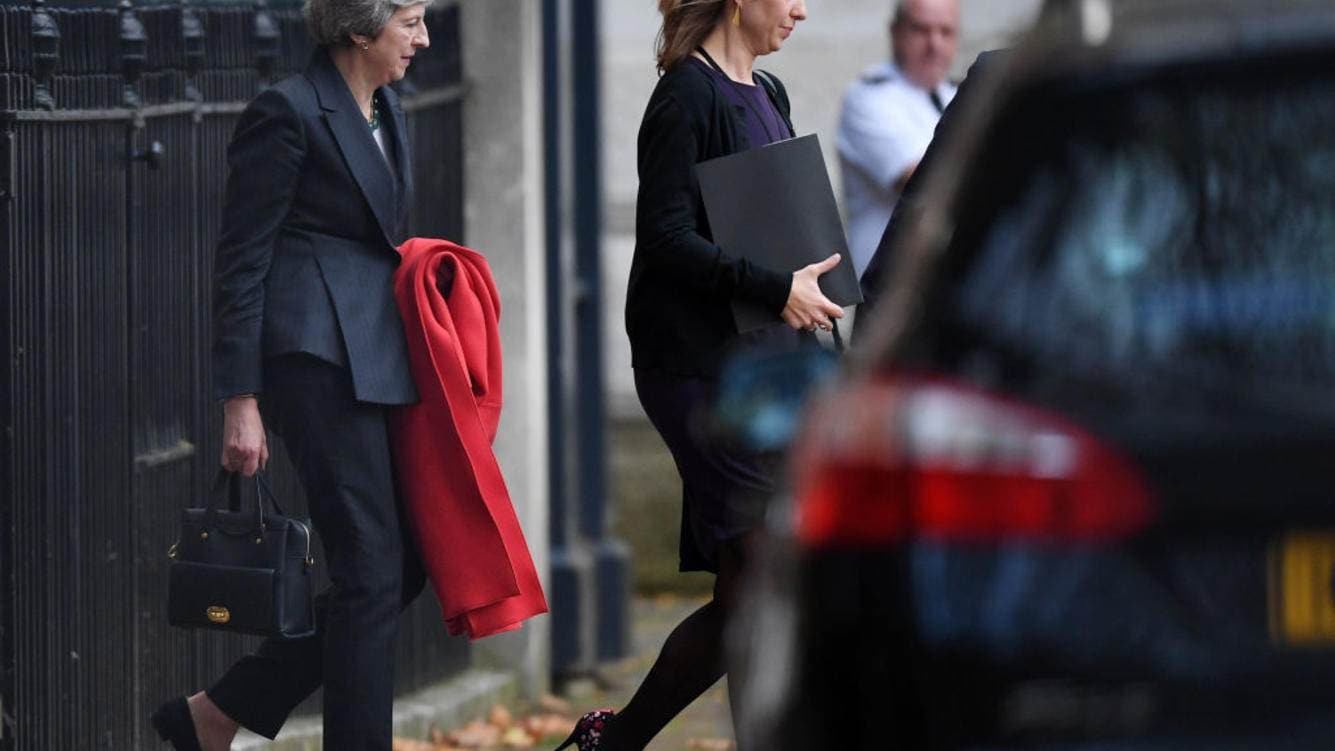British Prime Minister Theresa May leaves Number 10 Downing Street through the back door on November 15, 2018 in London, England. Cabinet Ministers Dominic Raab, the Brexit Secretary, and Esther McVey, Work and Pensions Secretary resigned this morning after last night's cabinet meeting backed the draft Brexit agreement. (Photo by Leon Neal/Getty Images)