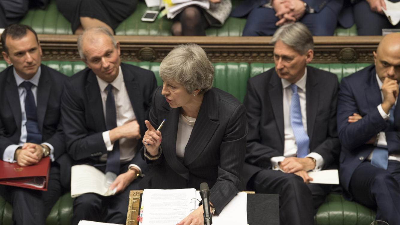Britain's Prime Minister Theresa May, centre, gives a reply to lawmakers during the scheduled Prime Minister's Questions time, in the House of Commons, London, Wednesday Dec. 5, 2018. Britain's House of Commons opened round two Wednesday in a bruising battle between lawmakers and Prime Minister Theresa May's government over Britain's Brexit split with the EU. (UK Parliament, Mark Duffy via AP)