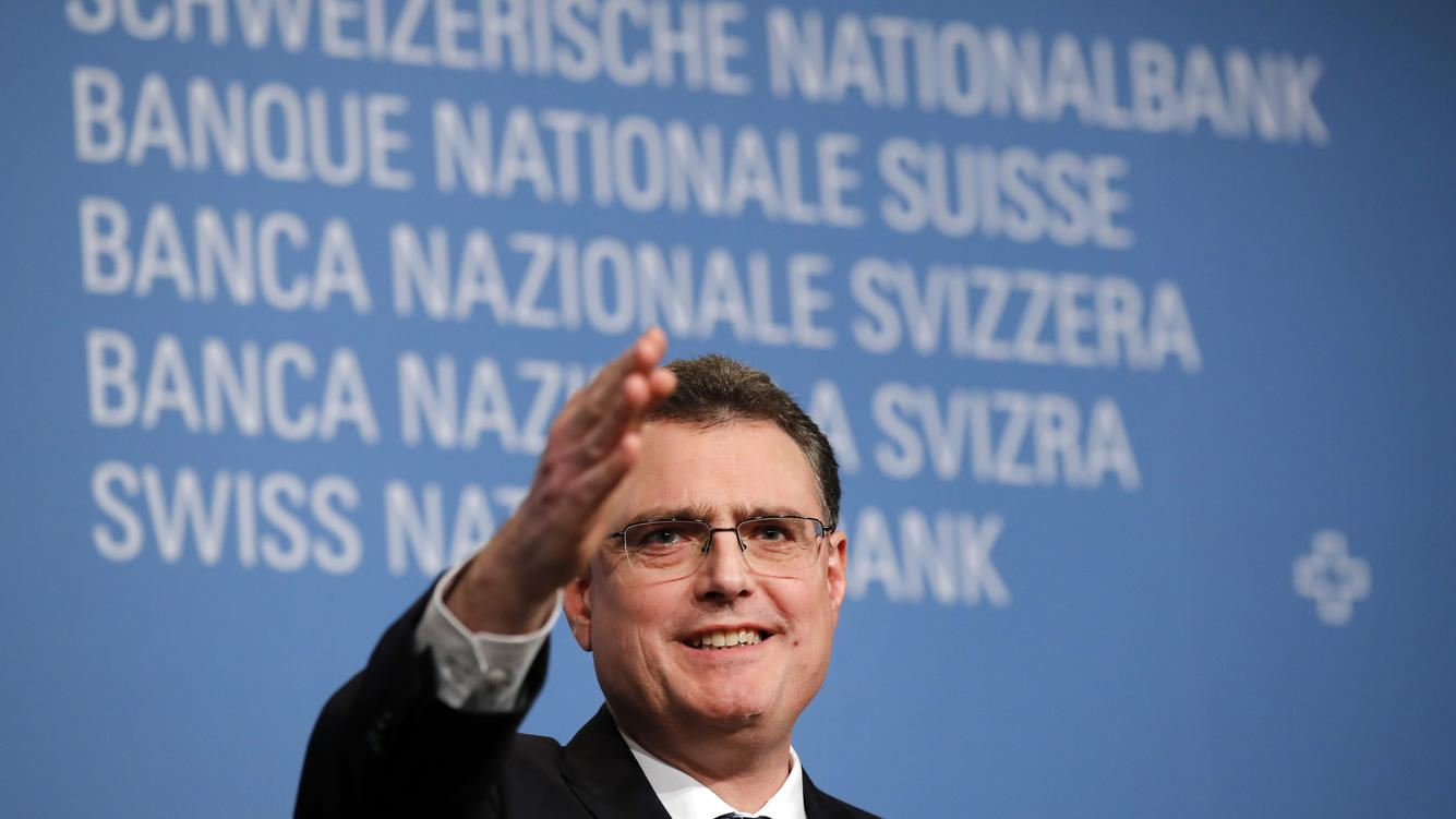 Thomas Jordan, president of the Swiss National Bank (SNB), gestures during the bank's rate announcement news conference in Bern, Switzerland, on Thursday, Dec. 13, 2018. The Swiss National Bank cut its inflation forecast and showed no inclination of moving off its crisis-era settings, citing the franc's strength and mounting global risks. Photographer: Stefan Wermuth/Bloomberg