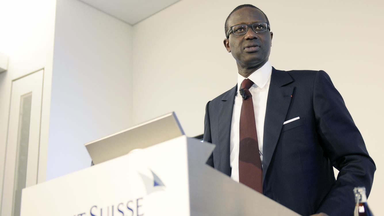 Tidjane Thiam, current head of British insurer Prudential, left, speaks during a press conference of Swiss Bank Credit Suisse in Zurich, Switzerland, Tuesday, 10 March 2015. The Board of Directors of Credit Suisse Group AG today has appointed Tidjane Thiam as the new CEO. He will take over this position from Brady W. Dougan, who will step down at the end of June 2015 after eight years as CEO of Credit Suisse Group. (KEYSTONE/Walter Bieri)