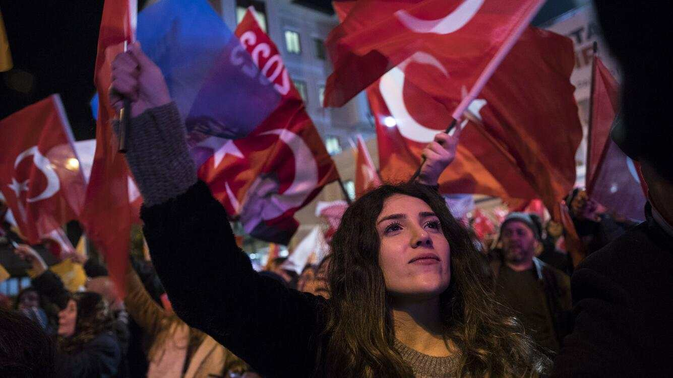 ISTANBUL, TURKEY - APRIL 01: People wave flags as they celebrate the unofficial results of local elections near AK Party's Istanbul Provincial Department in Istanbul, Turkey on April 01, 2019. (Photo by Arif Hudaverdi Yaman/Anadolu Agency/Getty Images)