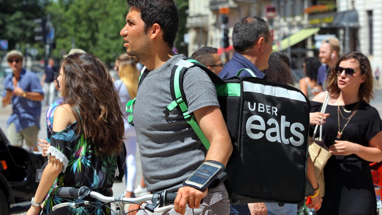 BORDEAUX, FRANCE - JUNE 24: An Uber Eats cyclist passes through the city center on June 24, 2018 in Bordeaux, France. Uber Eats was launched in 2014 and the company claims it is the largest food delivery service outside of China. It operates in more than 290 cities across the globe and is set to reach an annual revenue of $6bn. (Photo by David Silverman/Getty
