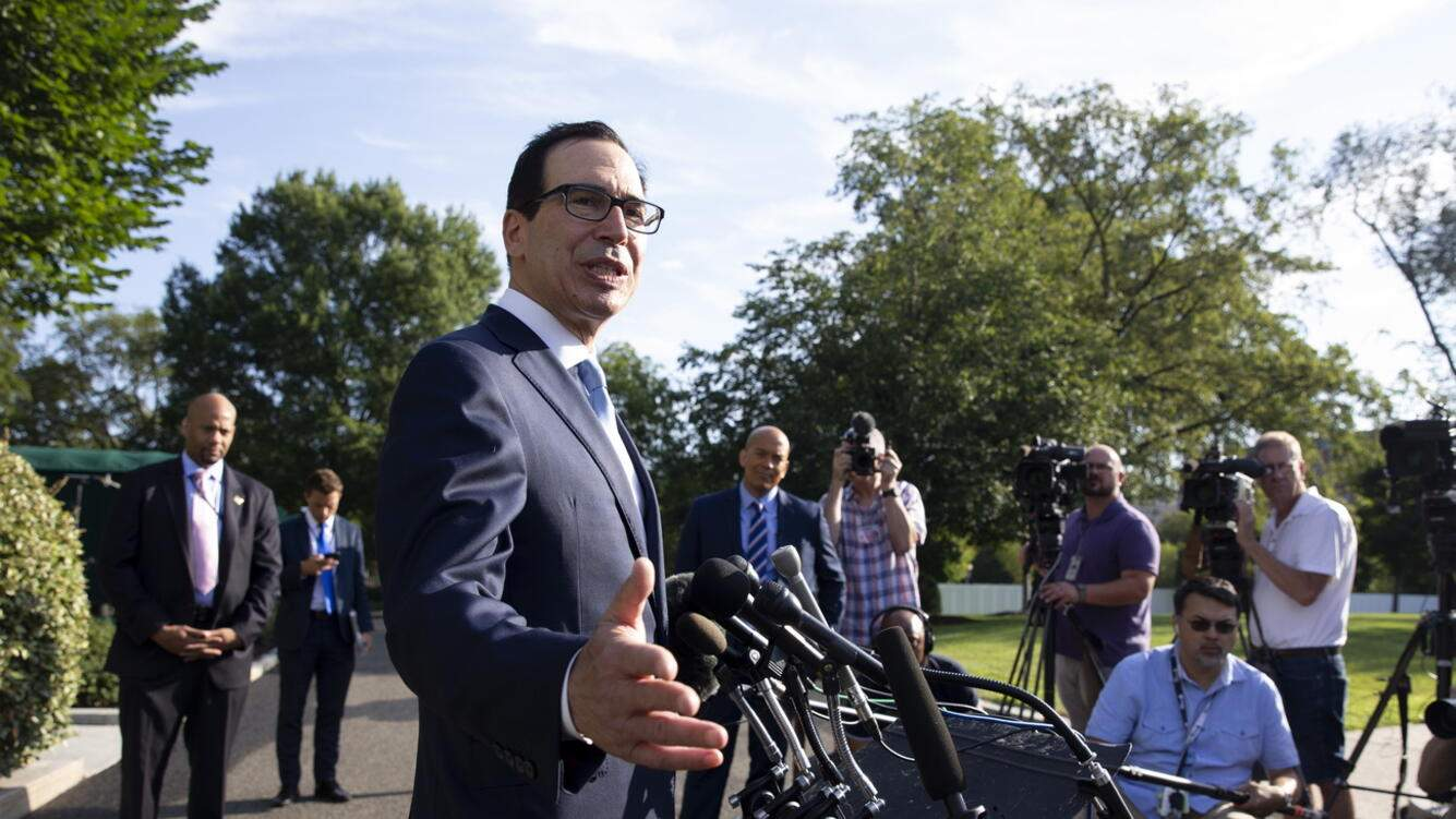 epa07737184 US Treasury Secretary Steven Mnuchin (C) takes questions from members of the news media outside the West Wing of the White House, in Washington, DC, USA, 24 July 2019. Mnuchin and US Trade Representative Robert Lighthizer will go to Shanghai next week for trade negotiations with China. EPA/MICHAEL REYNOLDS