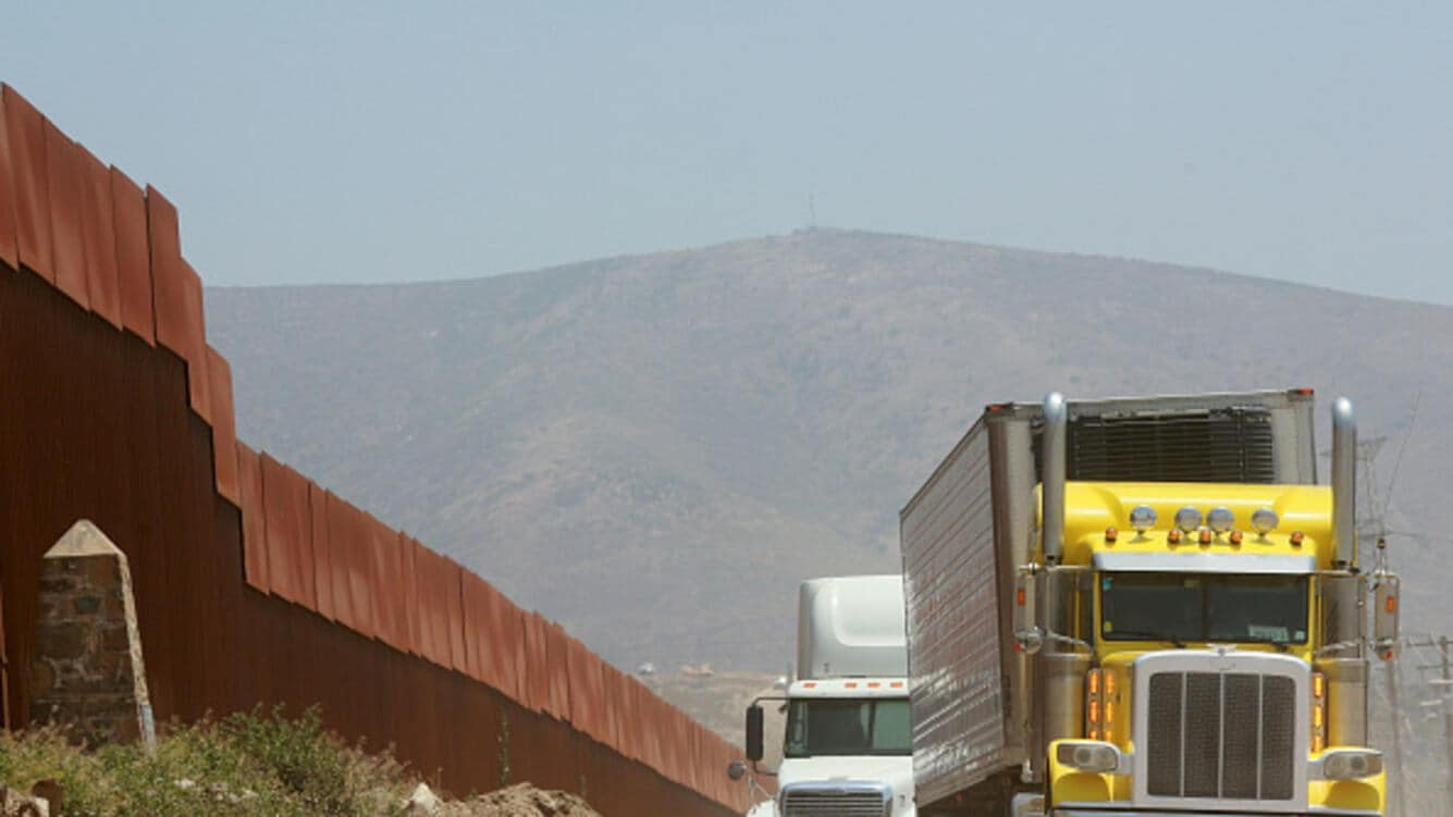 TIJUANA, MEXICO - MAY 31: Trucks wait in line to enter the United States on May 31, 2019 in Tijuana, Mexico. President Donald Trump has proposed a 5% tariff on Mexican goods entering the U.S. unless they help stop illegal immigration. (Photo by Sandy Huffaker/Getty Images)