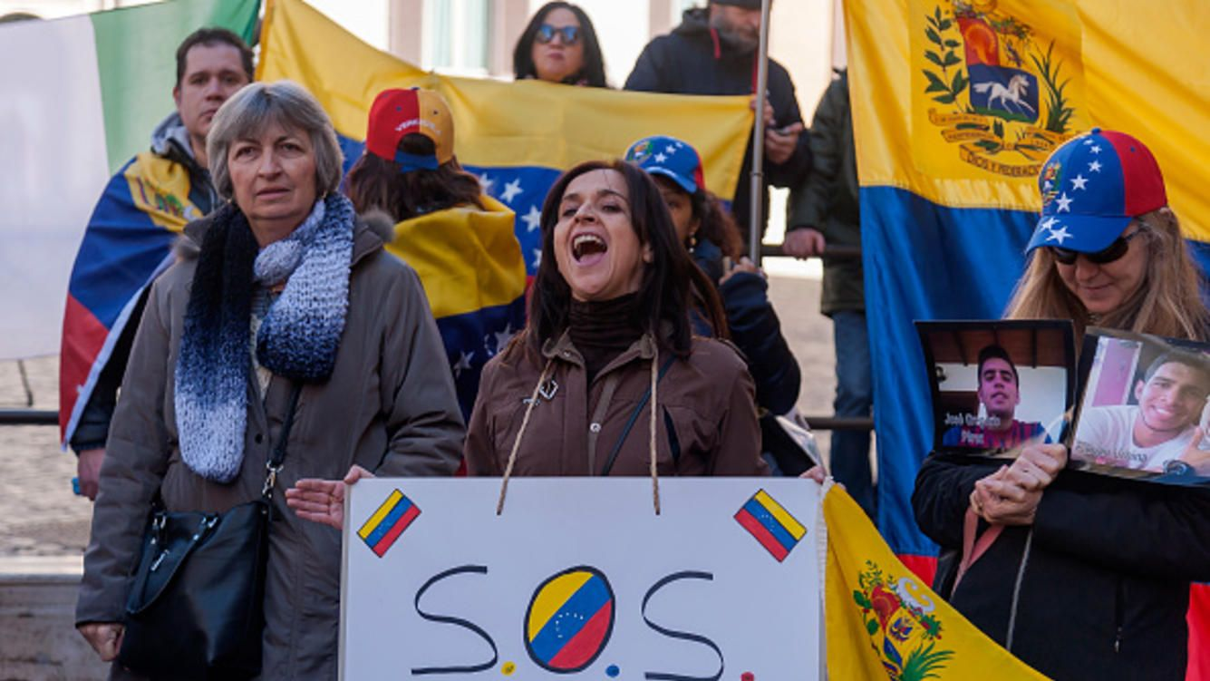 The Venezuelan community in Italy demonstrates in support of Juan Guaido and the people of the Bolivarian Republic of Venezuela and against Venezuelan president Nicolas Maduro in front Parliament on February 06, 2019 in Rome, Italy. (Photo by Stefano Montesi - Corbis/Getty Images)