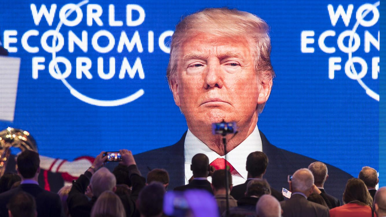Participants watch the appearance of Donald Trump, President of the United States of America, on screen from an adjacent room, during the 48th Annual Meeting of the World Economic Forum, WEF, in Davos, Switzerland, Friday, January 26, 2018. The meeting brings together entrepreneurs, scientists, corporate and political leaders in Davos, January 23 to 26. (KEYSTONE/Gian Ehrenzeller)