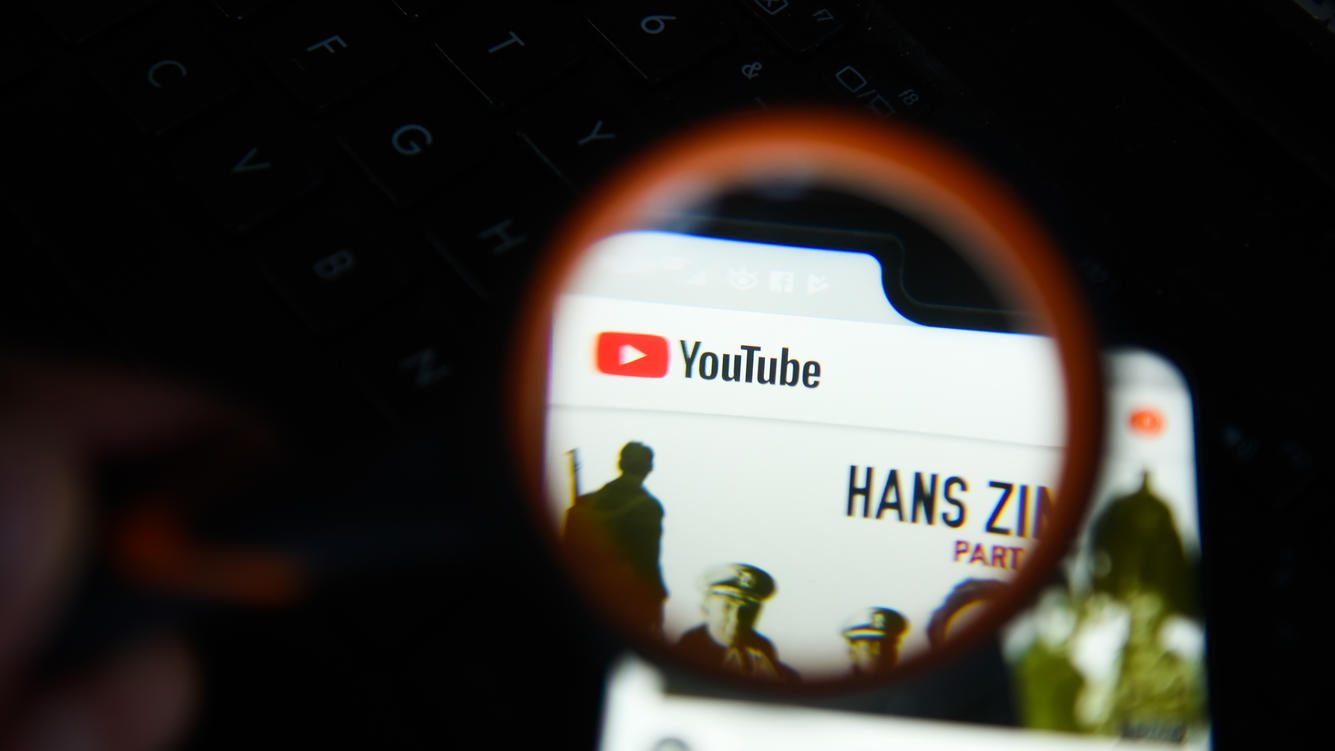 KRAKOW, POLAND - 2018/09/07: Youtube app is seen trough a magnifying glass on an android mobile phone. (Photo by Omar Marques/SOPA Images/LightRocket via Getty Images)