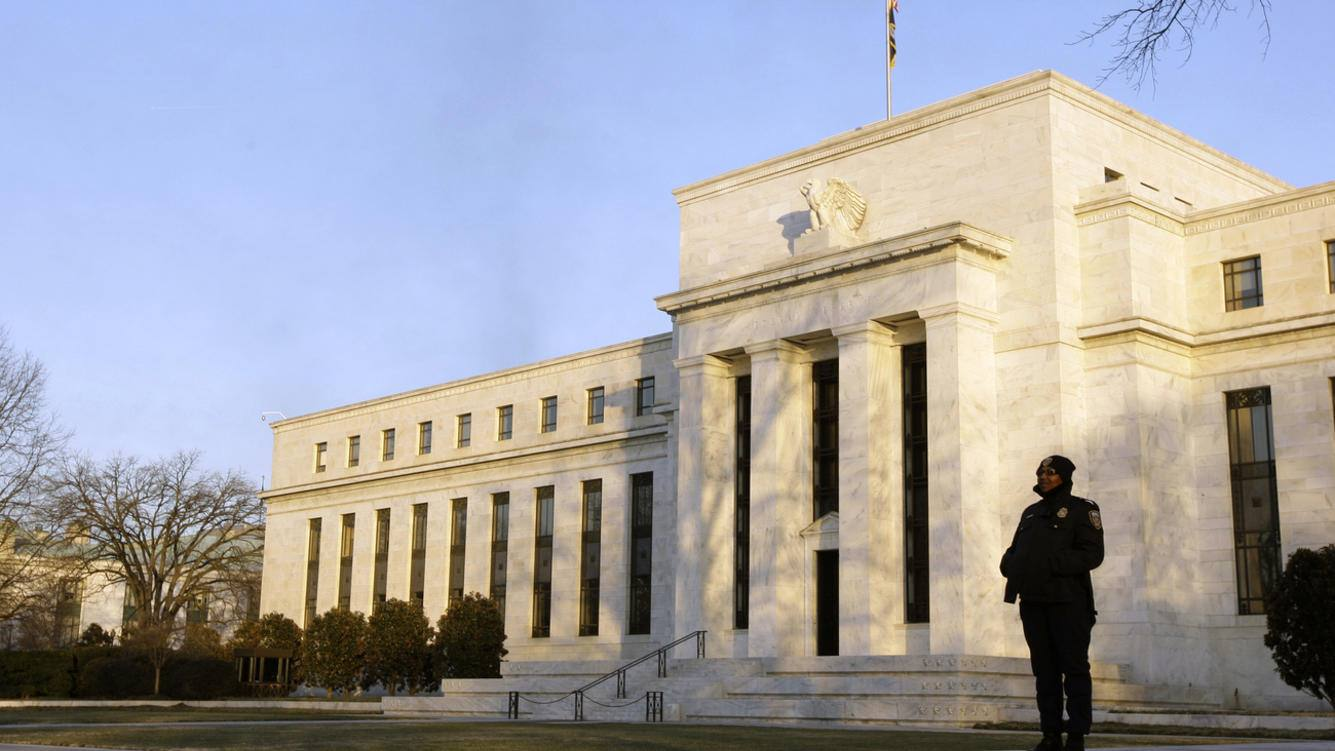 FILE - In this Jan. 14, 2010 file photo, a guard stands outside the Federal Reserve Building in Washington. The United States has never defaulted on its debt and leaders from both parties say they don't want it to happen now. But with partisan acrimony running at fever pitch, and Democrats and Republicans far apart on how to tame the deficit, anything could happen. (AP Photo/Alex Brandon, File)