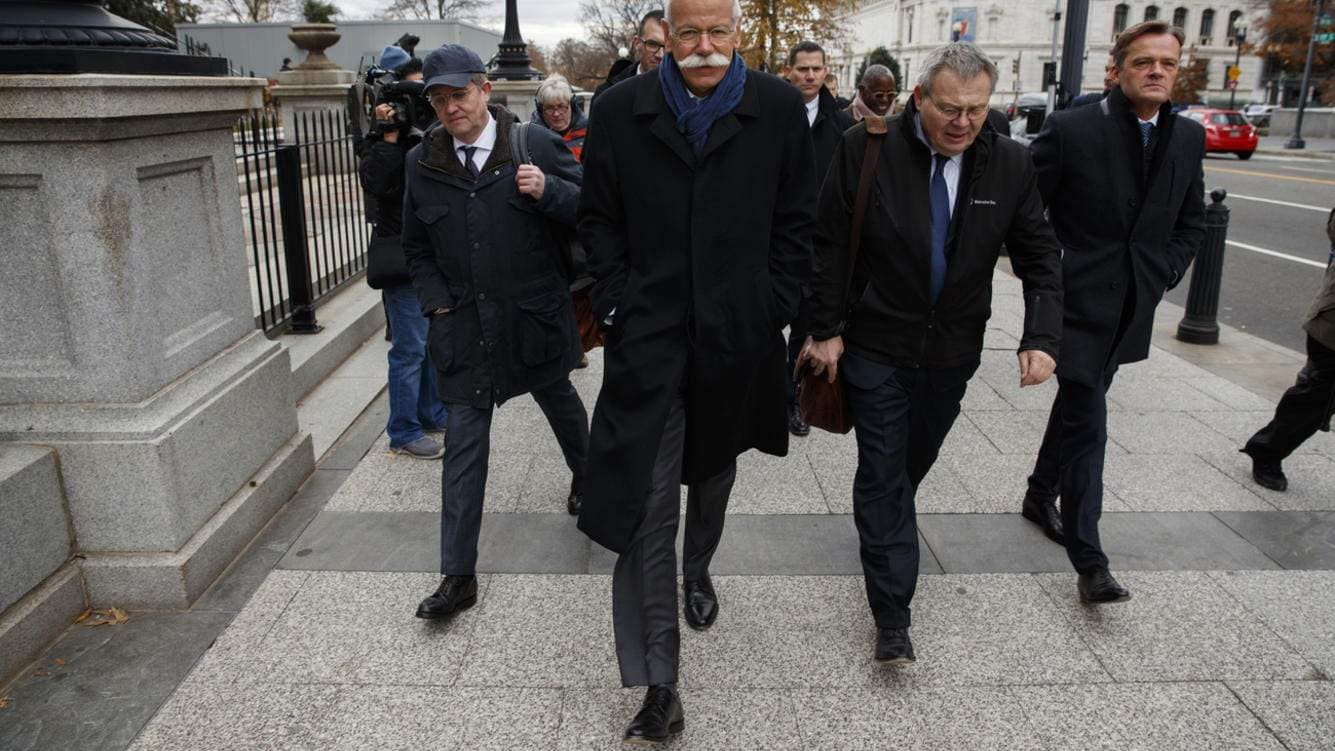 Daimler CEO Dieter Zetsche walks off after speaking with reporters after meeting with President Donald Trump at the White House, Tuesday, Dec. 4, 2018, in Washington. (AP Photo/Evan Vucci)