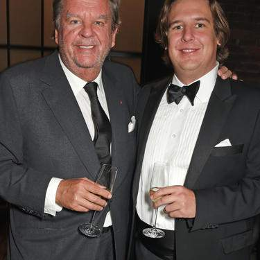 GENEVA, SWITZERLAND - JANUARY 16:  Johann Rupert (L) and son Anton Rupert Jr attend the IWC Schaffhausen Gala celebrating the Maison's 150th anniversary and the launch of its Jubilee Collection at the Salon International de la Haute Horlogerie (SIHH) on January 16, 2018 in Geneva, Switzerland. #IWC150  (Photo by David M. Benett/Dave Benett/Getty Images for IWC)