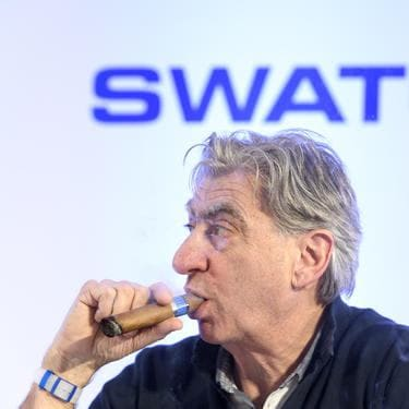 Nick Hayek, CEO Swatch Group, President of the Swatch Group Executive Management Boardsmokes his cigar during a press conference of the year 2017 final results of Swiss watch company Swatch Group, in Biel, Switzerland, this Wednesday, March 14, 2018. (KEYSTONE/Anthony Anex)