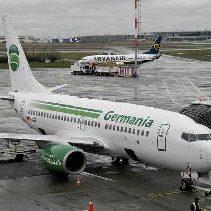 aircraft of German Germania airline is parked at Schoenefeld airport near Berlin. Germania has applied for insolvency. (Bernd Settnik/dpa via AP)