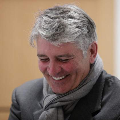 Former CEO of Global Wealth Management and Business Banking at UBS AG Raoul Weil shares a laugh with his lawyer during a break of the Swiss bank's trial at the Paris courthouse in Paris, Wednesday, Nov. 14, 2018. Swiss bank UBS AG stand trial in France for allegedly helping wealthy French clients evade the country's tax authorities. (AP Photo/Francois Mori)