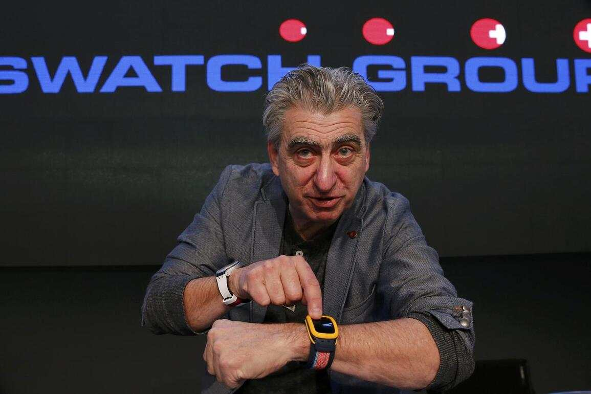 """Swatch Group CEO Nick Hayek poses with the new 'Swatch Touch Zero One' during the Swiss watchmaker's annual news conference in Corgemont March 12, 2015. Swatch's chief executive said on Thursday the Swiss watchmaker's outlook for 2015 was """"excellent"""", despite the recent surge in the value of the Swiss franc following the removal of a cap on the currency's value against the euro.  REUTERS/Denis Balibouse (SWITZERLAND  - Tags: BUSINESS)"""