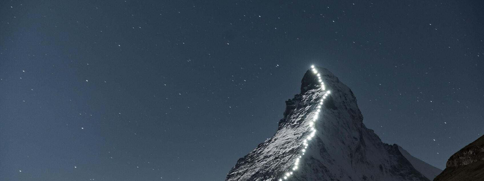 The Matterhorn mountain from Zermatt, Switzerland. Photographed at night, the lights are lanterns that follow the route the first explorers took to reach the peak.