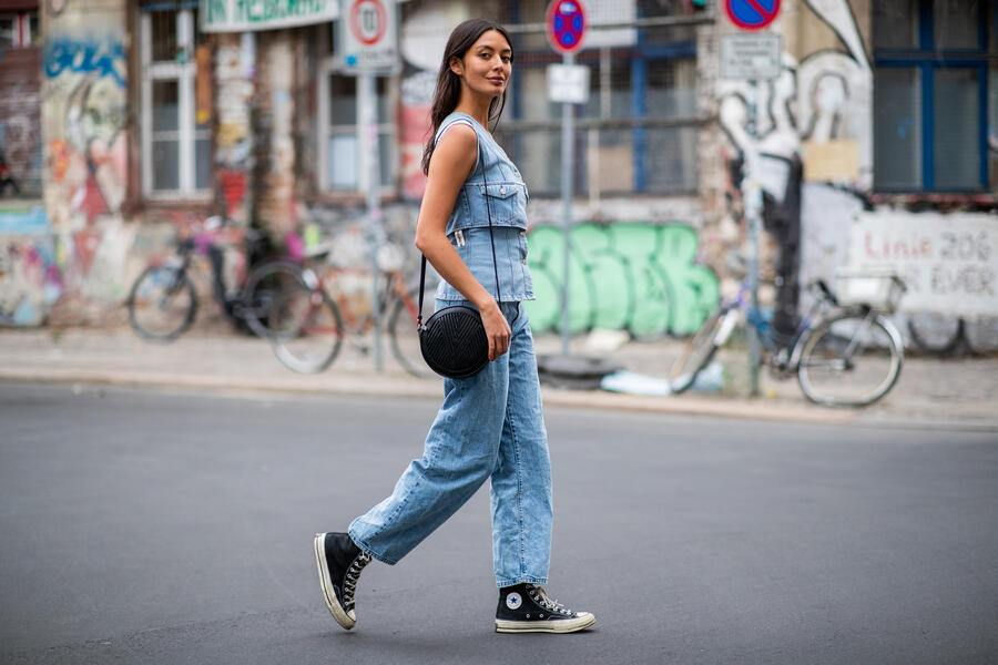 BERLIN, GERMANY - AUGUST 24: Alyssa Cordes wearing ripped off denim shirt Weekday, cropped denim jeans Weekday (natural born human), Converse chucks, Lili Radu bag on August 24, 2018 in Berlin, Germany. (Photo by Christian Vierig/Getty Images)