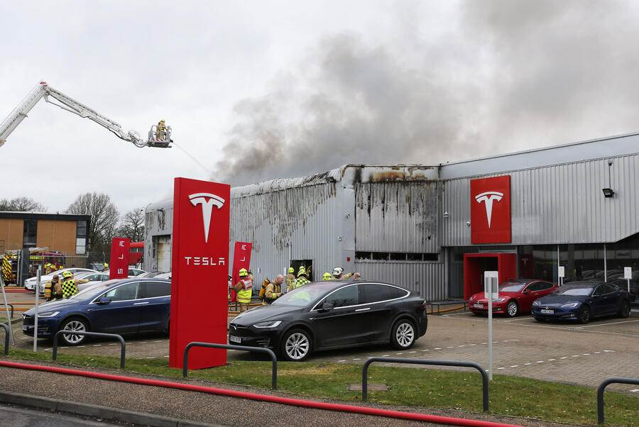 CRAWLEY, WEST SUSSEX - MARCH 02: (UK OUT)  Firefighters attend an incident at a Tesla dealership on March 2, 2019 in Crawley, West Sussex, England.  (Photo by Eddie Mitchell/Getty Images)