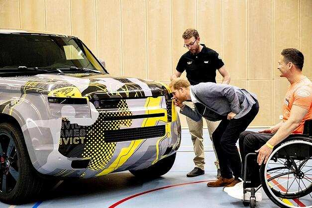 Prince Harry (C) looks at a car during the presentation of the Invictus Games The Hague 2020, in The Hague, Netherlands, on May 9, 2019. - The fifth Invictus Games The Hague 2020, an international sporting event for wounded, injured and sick servicepersonnel, will be held in the Zuiderpark in 2020. (Photo by patrick van katwijk / ANP / AFP) / Netherlands OUT (Photo credit should read PATRICK VAN KATWIJK/AFP/Getty Images)