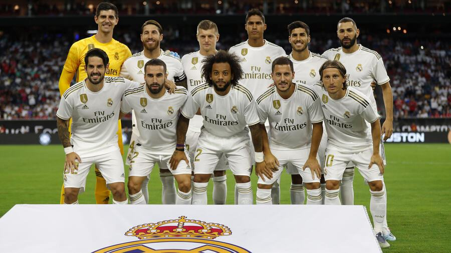 Thibaut Courtois of Real Madrid, Dani Carvajal of Real Madrid, Raphael Varane of Real Madrid, Sergio Ramos of Real Madrid, Marcelo Vieira of Real Madrid, Luka Modric of Real Madrid, Toni Kroos of Real Madrid, Isco Alarcon of Real Madrid, Marco Asensio of Real Madrid, Karim Benzema of Real Madrid and Eden Hazard of Real Madrid look on during the 2019 International Champions Cup match between FC Bayern Muenchen and Real Madrid at NRG Stadium on July 20, 2019 in Houston, Texas. (Photo by TF-Images/Getty Images