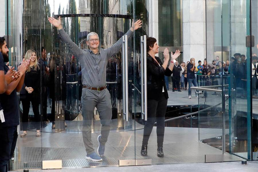 NEW YORK, NEW YORK - SEPTEMBER 20: Apple CEO Tim Cook and Apple SVP Retail+People Deirdre O'Brien open the doors at the grand reopening of Apple's flagship Apple Fifth Avenue retail store on September 20, 2019 in New York City. (Photo by Taylor Hill/WireImage)