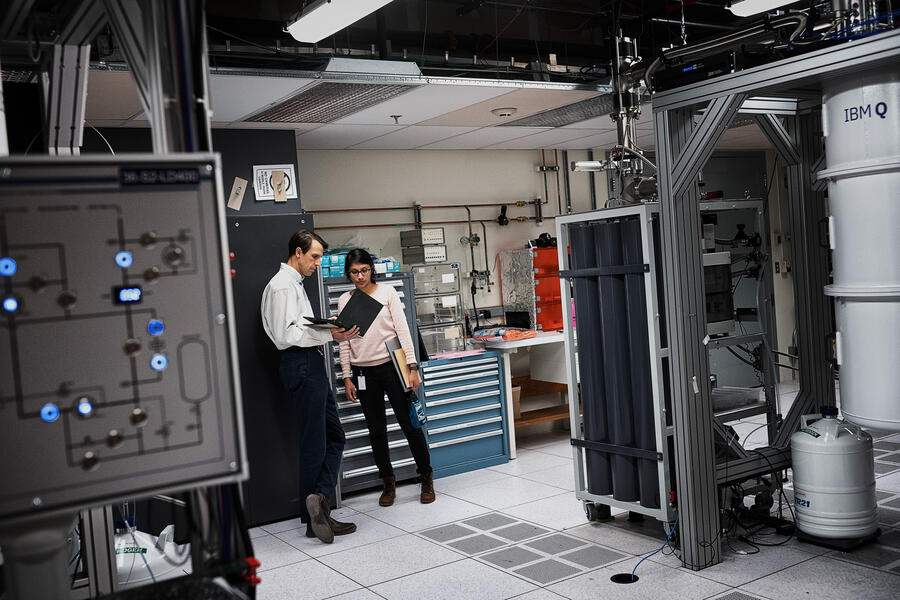 YORKTOWN HEIGHTS, N.Y. - OCTOBER 18: Neerja Sundaresan, Research Team Member, IBM Research, talking to Douglas McClure, next to IBM Q System One quantum computer on October 18, 2019 at IBM's research facility in Yorktown Heights, N.Y. (Photo by Misha Friedman/Getty Images)