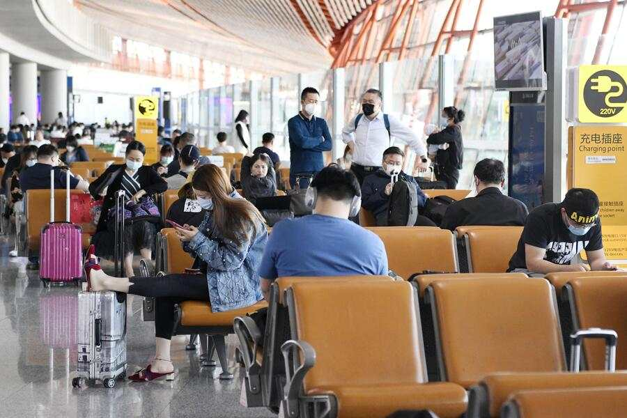 People wait at a boarding area for domestic flights at Beijing Capital International Airport on May 10, 2020. The Civil Aviation Administration of China said May 13 that the number of passengers carried by Chinese airlines in April plunged 68.5 percent from a year earlier amid the coronavirus pandemic. (Photo by Kyodo News via Getty Images)