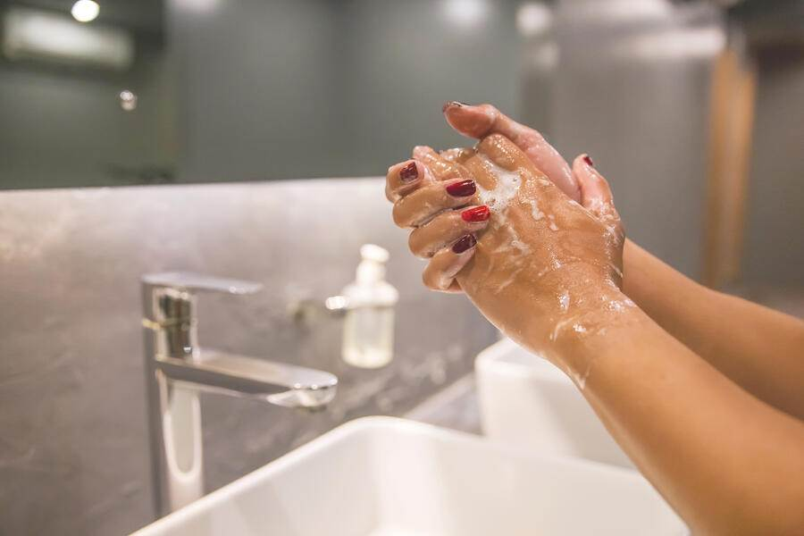 Close up shot of Asian female hands washing hands with soap