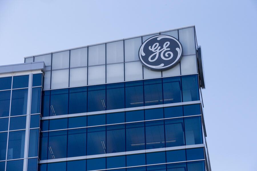 FILE- In this Jan. 16, 2018, file photo, the General Electric logo is displayed at the top of their Global Operations Center in the Banks development of downtown Cincinnati. General Electric is shuffling leadership at its power unit as it moves to split the division in its ongoing effort to slim down operations. (AP Photo/John Minchillo, File)