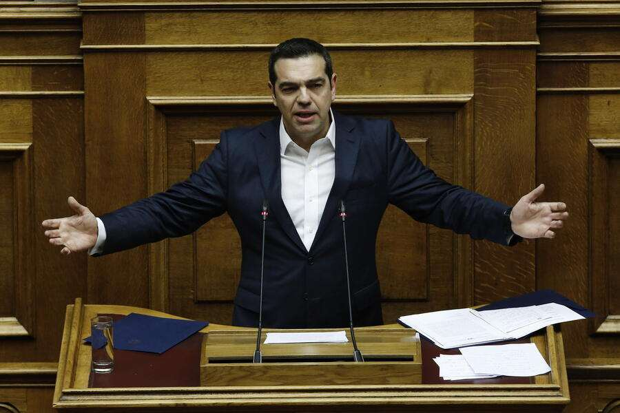 epa07290744 Greek Prime Minister Alexis Tsipras delivers his speech during a debate on the vote of confidence in the government, in the parliament's plenum, in Athens, Greece, 16 January 2019. Greek deputies will be called to give their vote of confidence in the government on 16 January midnight, after a two-day debate in parliament.  EPA/YANNIS KOLESIDIS