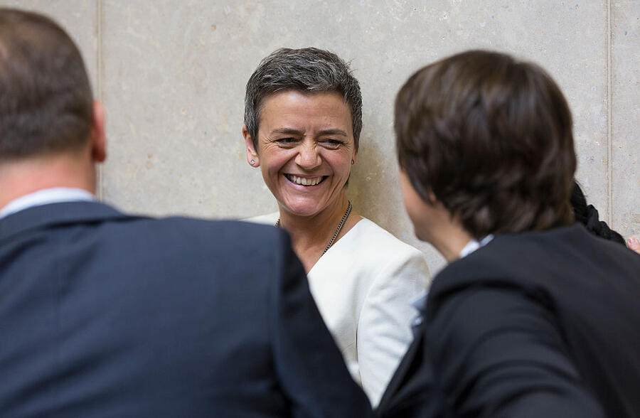 Brussels, Belgium, May 6, 2015. -- EU Competition Commissioner Margrethe Vestager (C) is talking with colleagues prior an EU Commission college meeting in the Berlaymont, the European Union Commission headquarters. (Photo by Thierry Tronnel/Corbis via Getty Images)