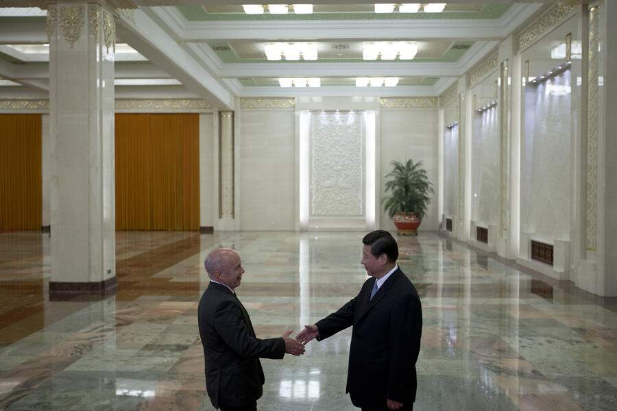 Swiss President Ueli Maurer, left, shakes hands with Chinese President Xi Jinping before their meeting at the Great Hall of the People in Beijing, China, Thursday, July 18, 2013. (AP Photo/Alexander F. Yuan, Pool)