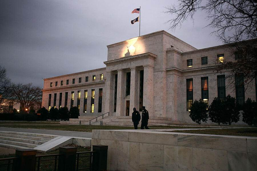 WASHINGTON - DECEMBER 16:  Flags fly over the Federal Reserve Building on December 16, 2008 in Washington, D.C. The Fed began its last meeting of 2008 today, where it is expected to announced another reduction in the key interest rate, amongst other measures meant to stimulate the economy.  (Photo by Mark Wilson/Getty Images)
