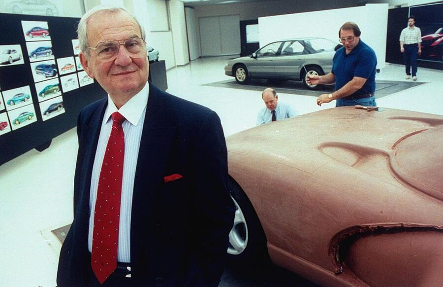 Chrysler Corp. Chmn. Lee Iacocca posing in front of full-sized clay model of the proposed Viper sports car being worked on by staff technicians in the Advanced International Design studio at the new Chrysler Tech Center.  (Photo by Taro Yamasaki/The LIFE Images Collection via Getty Images/Getty Images)