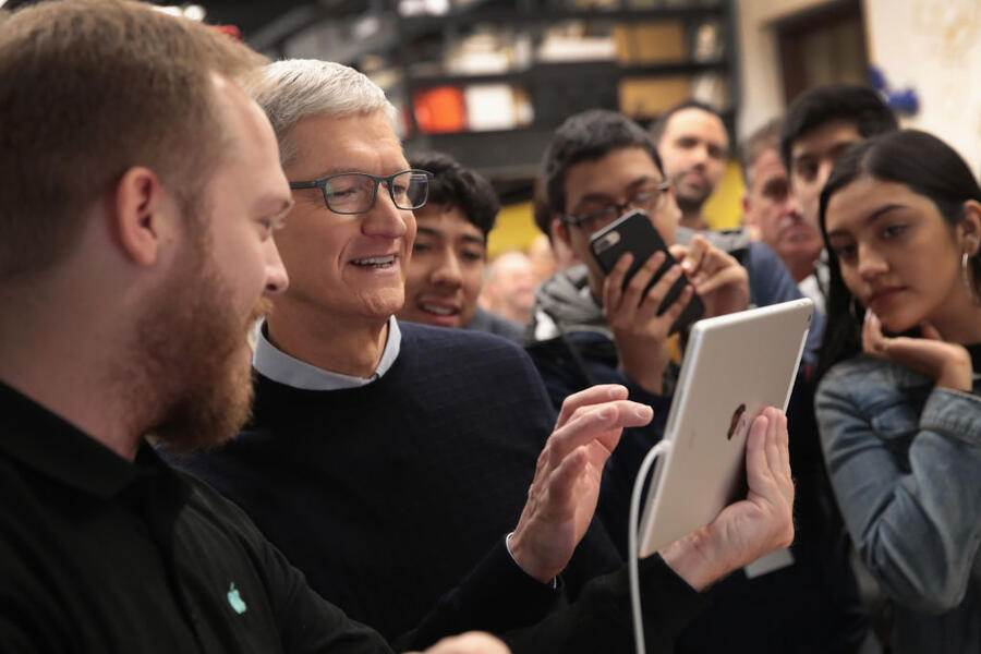 CHICAGO, IL - MARCH 27:  Apple CEO Tim Cook gets a demonstration of an app during an event held to introduce the new 9.7-inch Apple iPad at Lane Tech College Prep High School on March 27, 2018 in Chicago, Illinois. The device will work with Apple Pencil and is available now.  (Photo by Scott Olson/Getty Images)