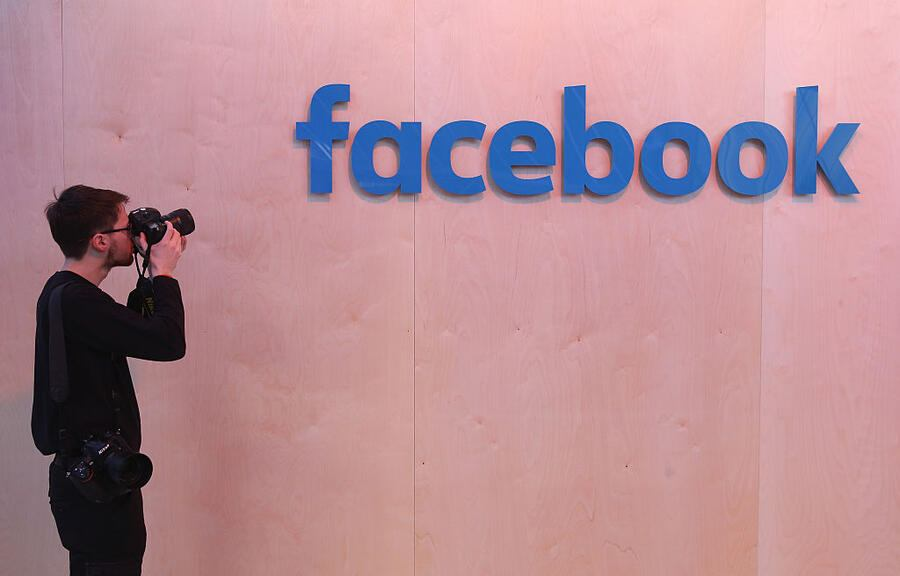 BERLIN, GERMANY - FEBRUARY 24:  A photographer snaps a photo of the Facebook logo at the Facebook Innovation Hub on February 24, 2016 in Berlin, Germany. The Facebook Innovation Hub is a temporary exhibition space where the company is showcasing some of its newest technologies and projects.  (Photo by Sean Gallup/Getty Images)