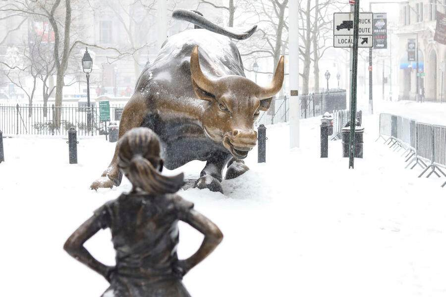 NEW YORK, NY - MARCH 14: Snow accumulates on 'The Fearless Girl' statue during a blizzard on March 14, 2017 in New York City. A blizzard is forecast to bring more than a foot of snow and high winds to up to eight states in the Northeast region as New York and New Jersey are under a state of emergency. School districts across the entire region were closed and thousands of flights were canceled. (Photo by William Volcov/Brazil Photo Press/LatinContent via Getty Images)