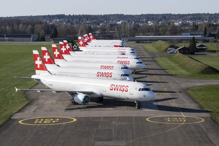Parked planes of the airline Swiss at the airport in Duebendorf, Switzerland on Monday, 23 March 2020. The bigger part of the Swiss airplanes are not in use due to the outbreak of the coronavirus. (KEYSTONE/Ennio Leanza)