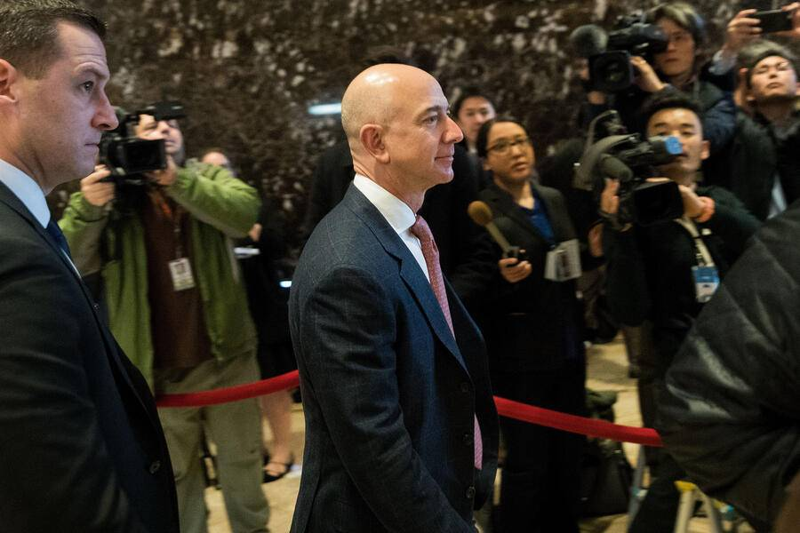 NEW YORK, NY - DECEMBER 14: Jeff Bezos, chief executive officer of Amazon, arrives for a meeting with President-elect Donald Trump at Trump Tower, December 14, 2016 in New York City. This is the first major meeting between President-elect Trump and technology industry leaders. (Photo by Drew Angerer/Getty Images)