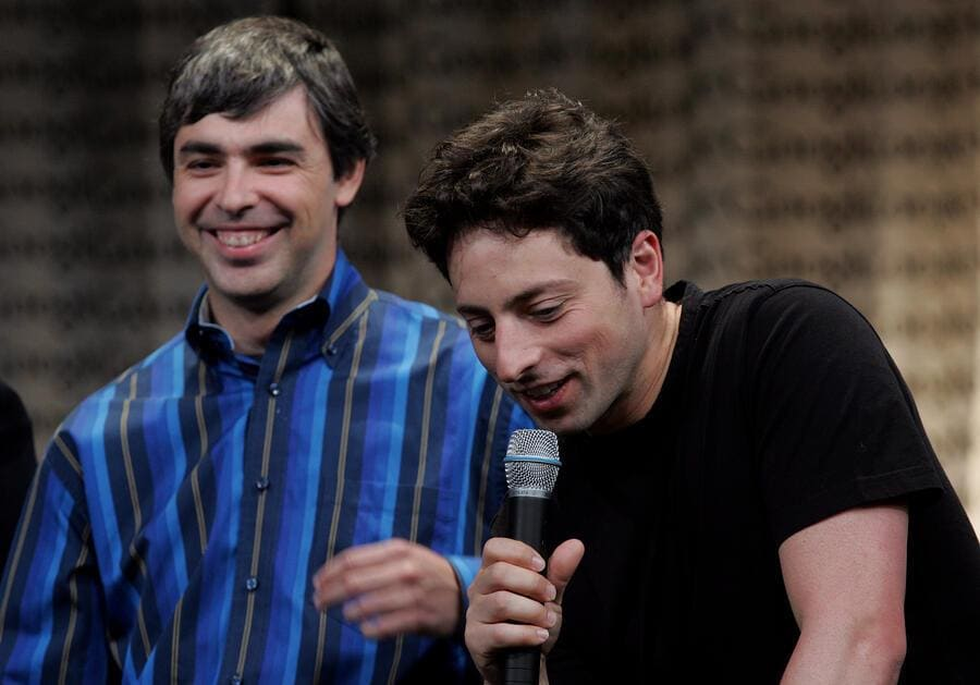 MOUNTAIN VIEW, CA - MAY 10:  Google founders Larry Page (L) Sergey Brin talk with members of the media at Google Press Day 2006 May 10, 2006 in Mountain View, California.  (Photo By Justin Sullivan/Getty Images)