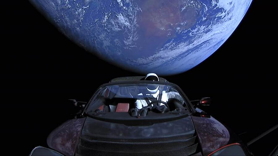 """IN SPACE - FEBRUARY 8: In this handout photo provided by SpaceX, a Tesla roadster launched from the Falcon Heavy rocket with a dummy driver named """"Starman""""  heads towards Mars. (Photo by SpaceX via Getty Images)"""