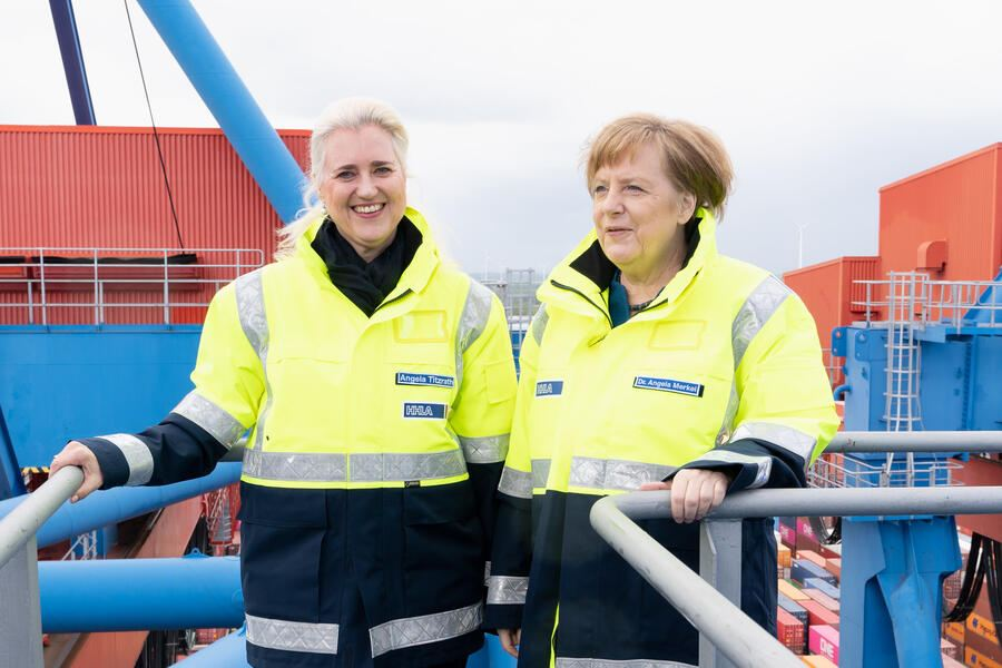 HAMBURG, GERMANY - MAY 6:  Angela Titzrath and Chancellor Angela Merkel on a container bridge during the Chancellor's visit to the Hamburger Hafen and Logistik AG Container Terminal Altenwerder on May 6, 2019 in Hamburg, Germany. (Photo by Chris Emil Janssen - Pool /Getty Images)