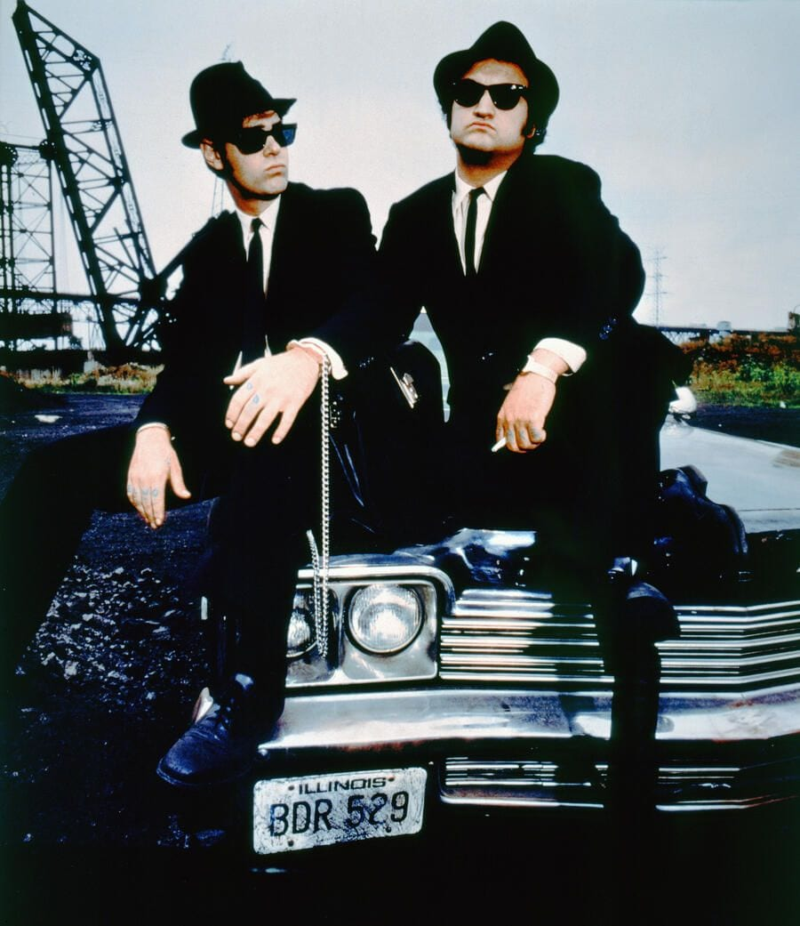 Canadian actor and screenwriter Dan Aykroyd and American actor John Belushi on the set of The Blues Brothers directed by John Landis. (Photo by Sunset Boulevard/Corbis via Getty Images)