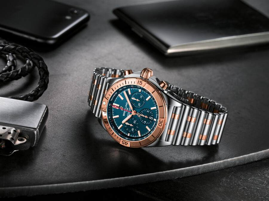Two-tone Chronomat B01 42 with a blue dial and tone-on-tone chronograph counters highlighted by an 18 k red gold bezel, crown and pushers