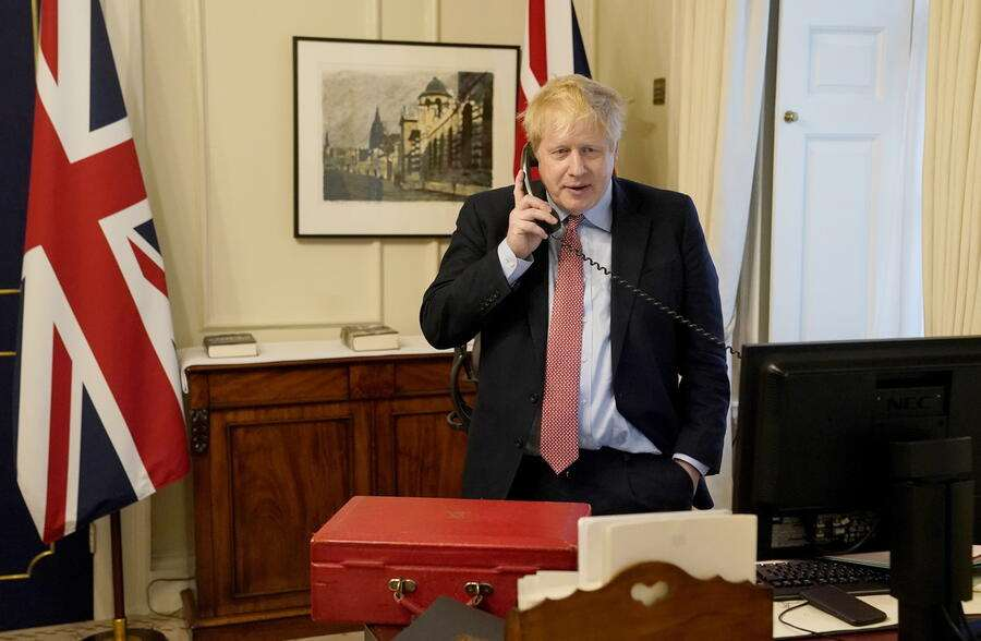 epa08323341 A handout photograph provided by No.10 Downing Street showing British Prime Minister Boris Johnson speaking to Queen Elizabeth II during their weekly audience, London, Britain 25 March 2020. EPA/ANDREW PARSONS/DOWNING STREET HANDOUT This image is for Editorial use purposes only. The Image can not be used for advertising or commercial use. Credit should read Andrew Parsons/No.10 Downing street. HANDOUT EDITORIAL USE ONLY/NO SALES