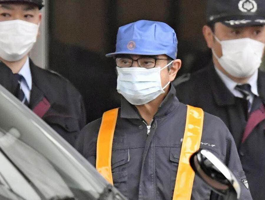 In this March 4, 2019, photo, former Nissan Chairman Carlos Ghosn, center with blue cap, leaves Tokyo's Detention Center in Tokyo, Wednesday, March 6, 2019. Ghosn was released Wednesday after putting up 1 billion yen ( million) in bail. (Yu Nakajima/Kyodo News via AP, File)