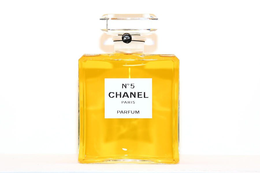 """PARIS, FRANCE - MAY 30:  Chanel N5 perfum in display at the Chanel Opening Party for the Exhibition """"Dans les Champs de Chanel"""" at Jardin des Tuileries on May 30, 2018 in Paris, France.  (Photo by Pascal Le Segretain/Getty Images)"""